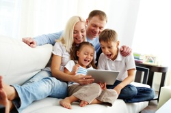 Happy family shopping on tablet