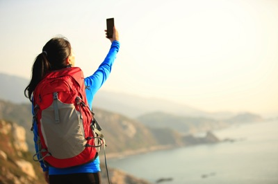 "Why Hotel Marketers Must Think ""Backyard and Bundle"" When Demand Returns: Guest taking a selfie while hiking"