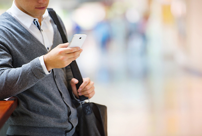 Why Mobile and Data Go Hand-in-Hand for Marketers: Business person using mobile to research product
