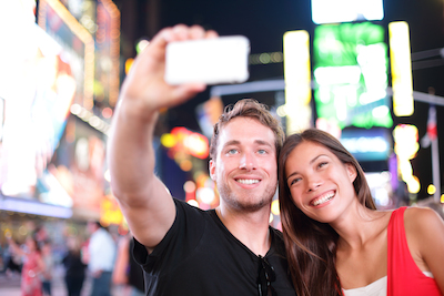 Mobile, Millennials, and hotel marketing: young couple enjoying travel together