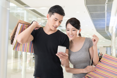 Millennials drive e-commerce growth: Young couple shopping on mobile