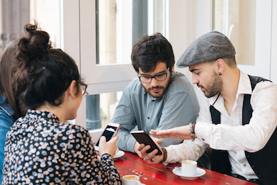 Amazing digital marketing messages: Young professionals using mobile devices to conduct business
