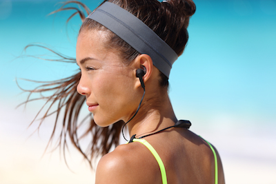 Mobile is a situation: Woman interacting with smart headphones