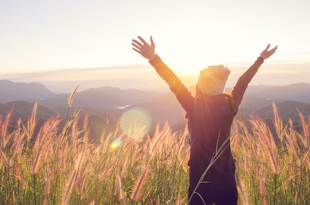 Why you should be optimistic right now: Woman joyfully embracing the future